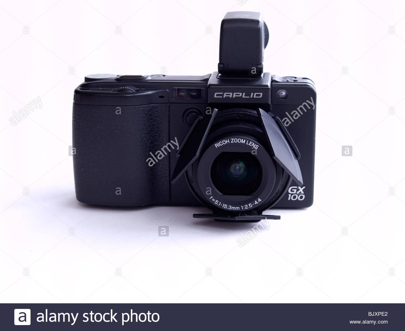 Ricoh Caplio GX100 compact digital camera on a white background 1300x1064