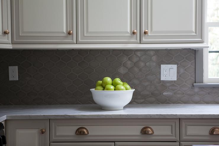 Raised Panel Kitchen Cabinets with Gray Geometric Tile Backsplash 740x493
