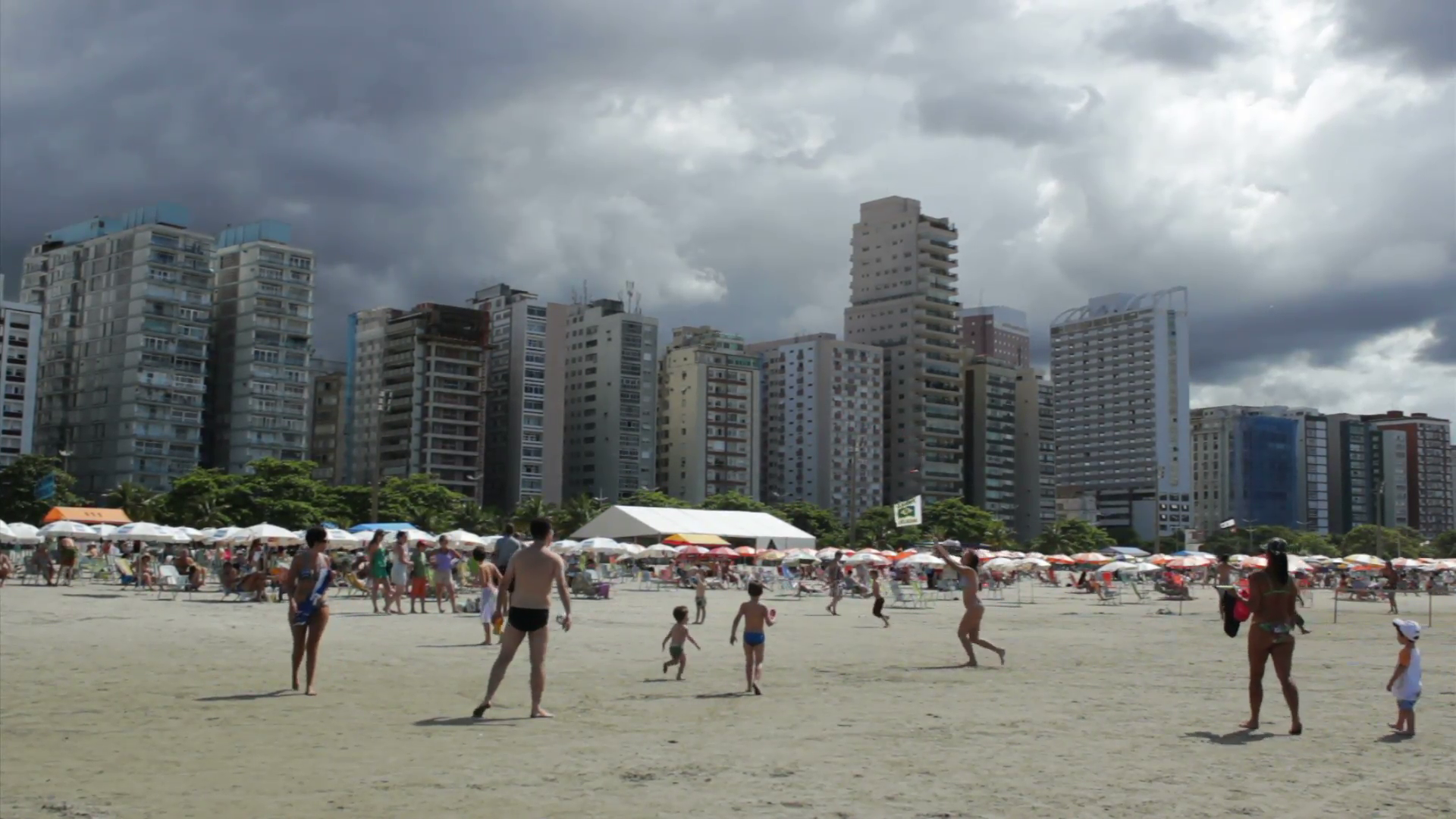 People enjoying a summer day at Santos beach Santos Sao Paulo 1920x1080