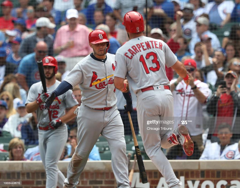 St Louis Cardinals catcher Yadier Molina congratulates teammate 1024x801