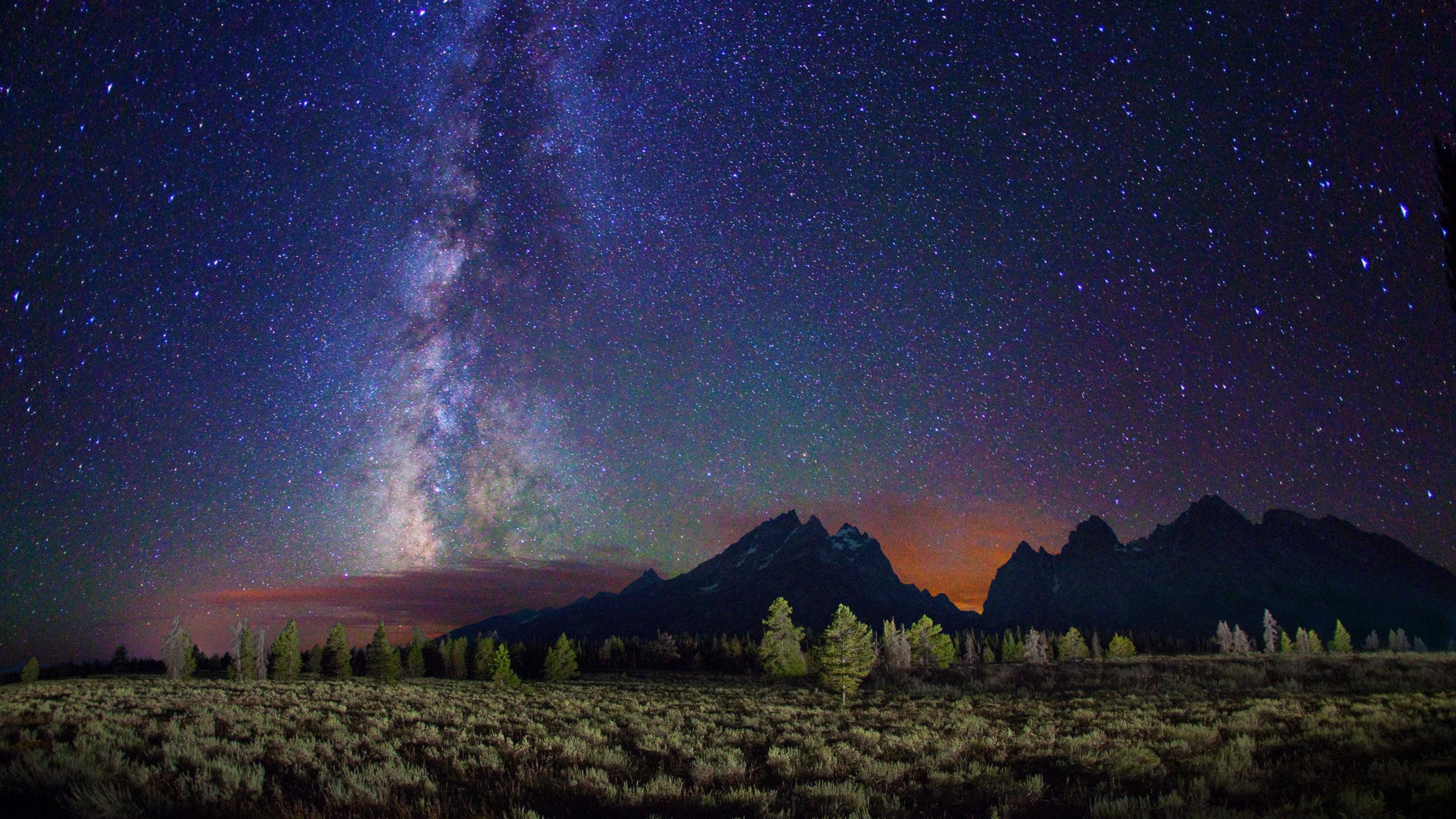 Wallpaper 3840x2160 milky way stars mountains field night 4K 3840x2160