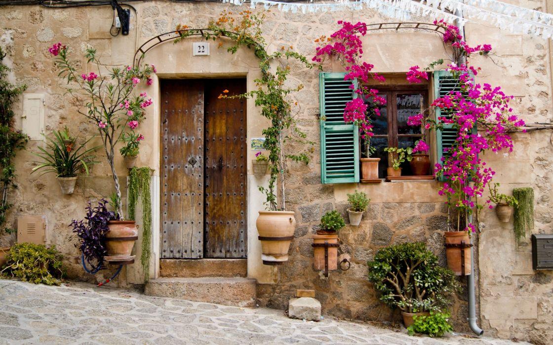 Provence Mallorca buildings stoop door window flowers wallpaper 1120x700