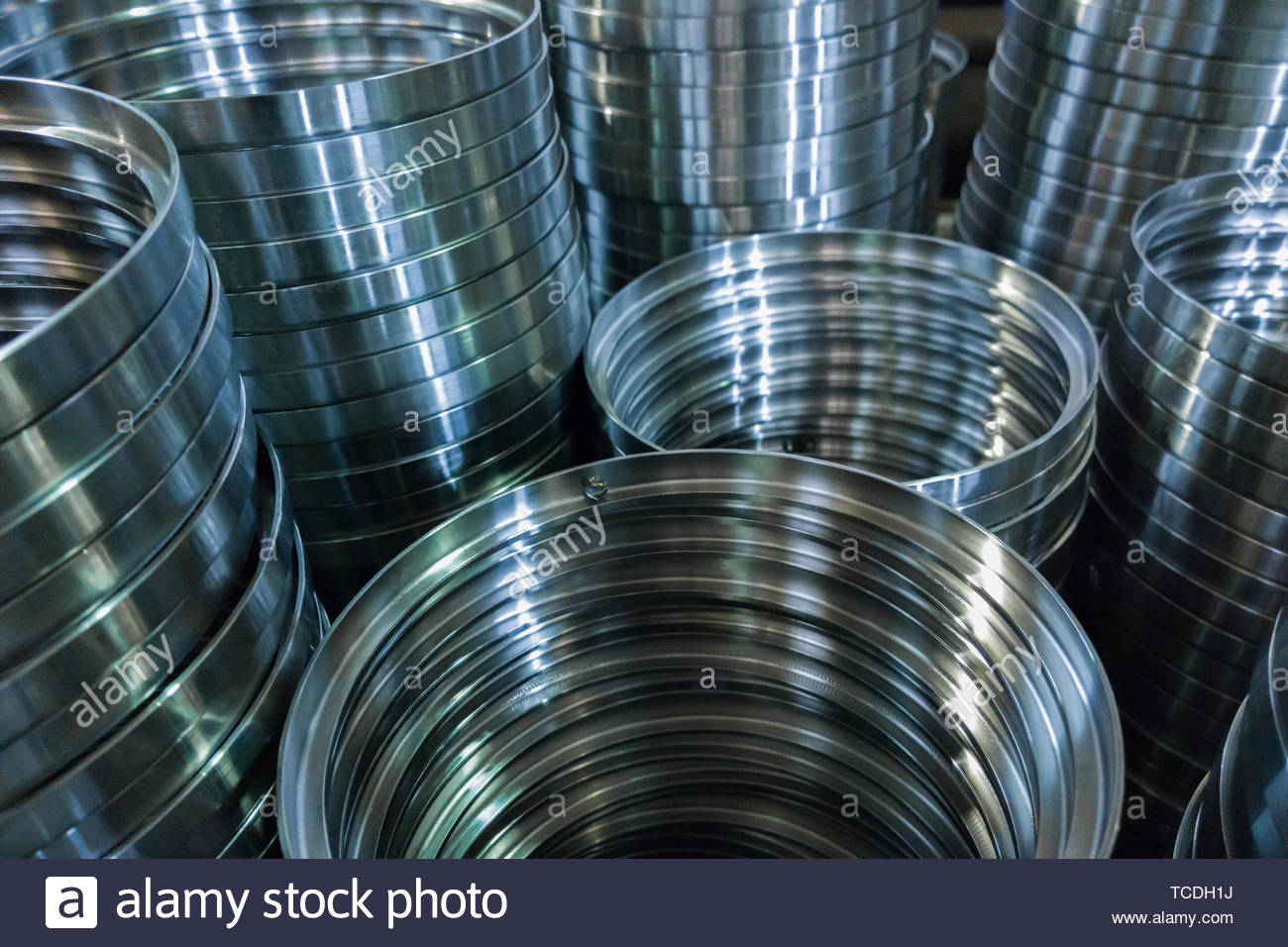 industrial manufacturing background of columns of shiny metal 1300x956