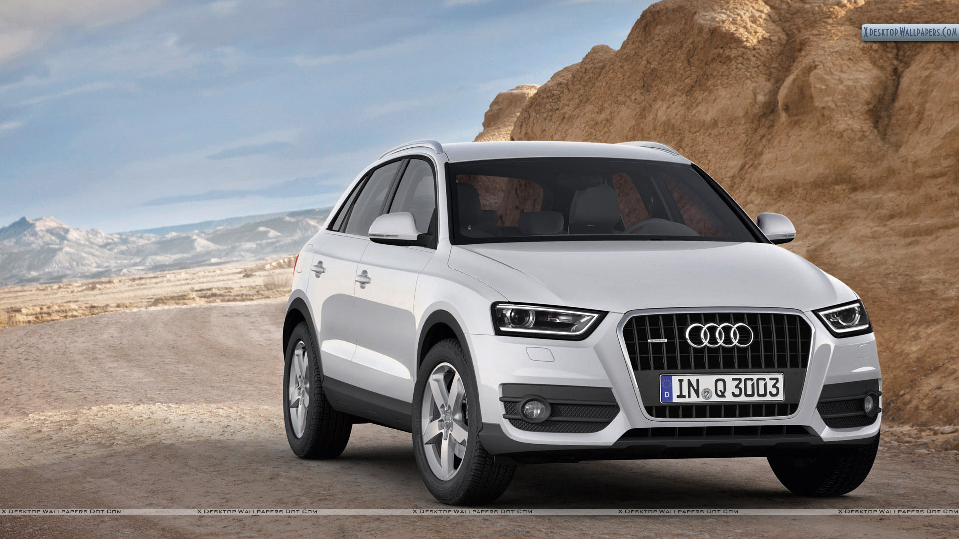 Audi Q3 in White Color Closeup Wallpaper 1920x1080
