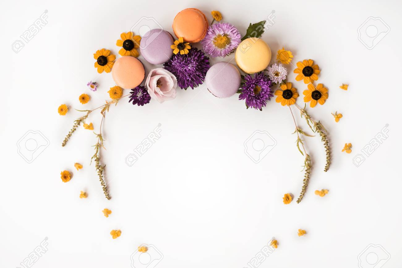 Macarons And Flowers Wreath On A White Background Colorful French 1300x866