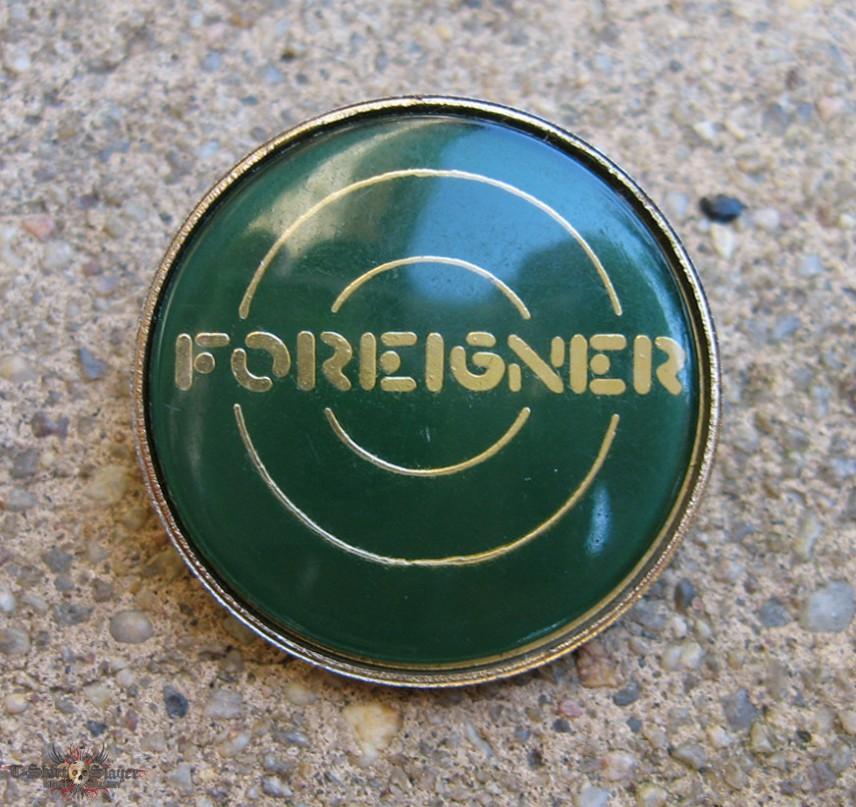FOREIGNER Logo vintage crystalenameled badge green background 856x807