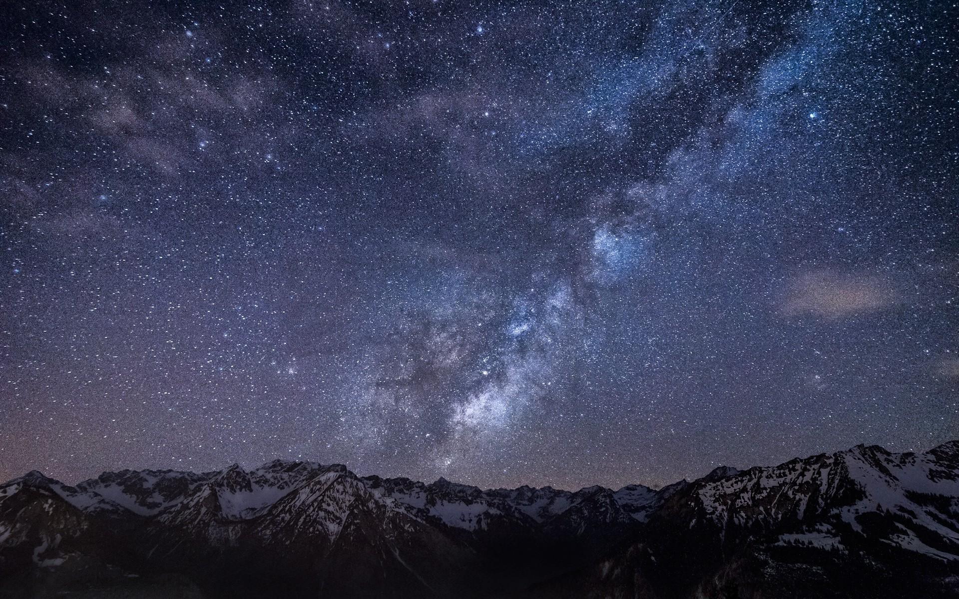 Starry sky over the mountain peak Wallpaper 1920x1200