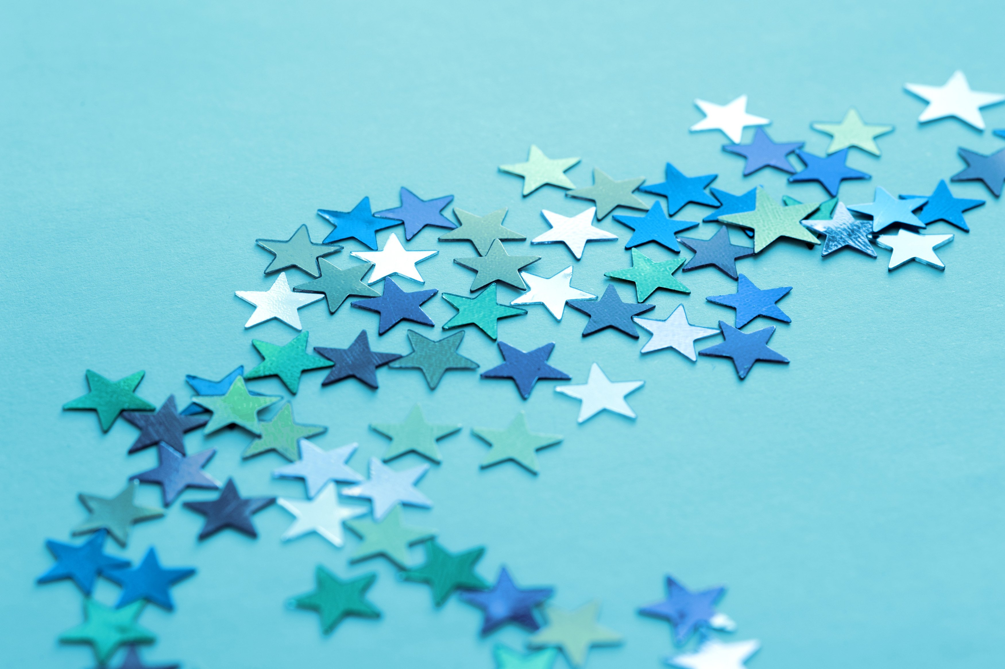 image of Blue and Silver Stars Scattered on Teal Background 3500x2329