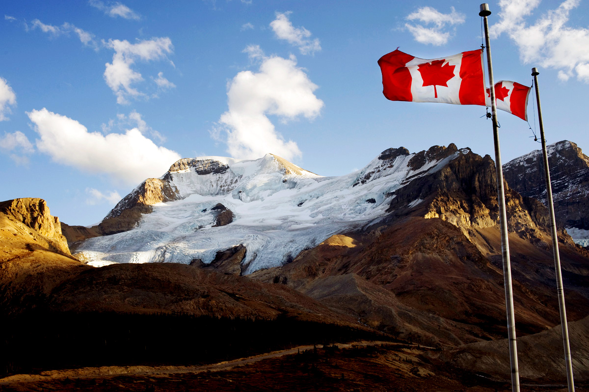 Waving Canadian Flags and Mountain Landscape HD Wallpaper 1200x798