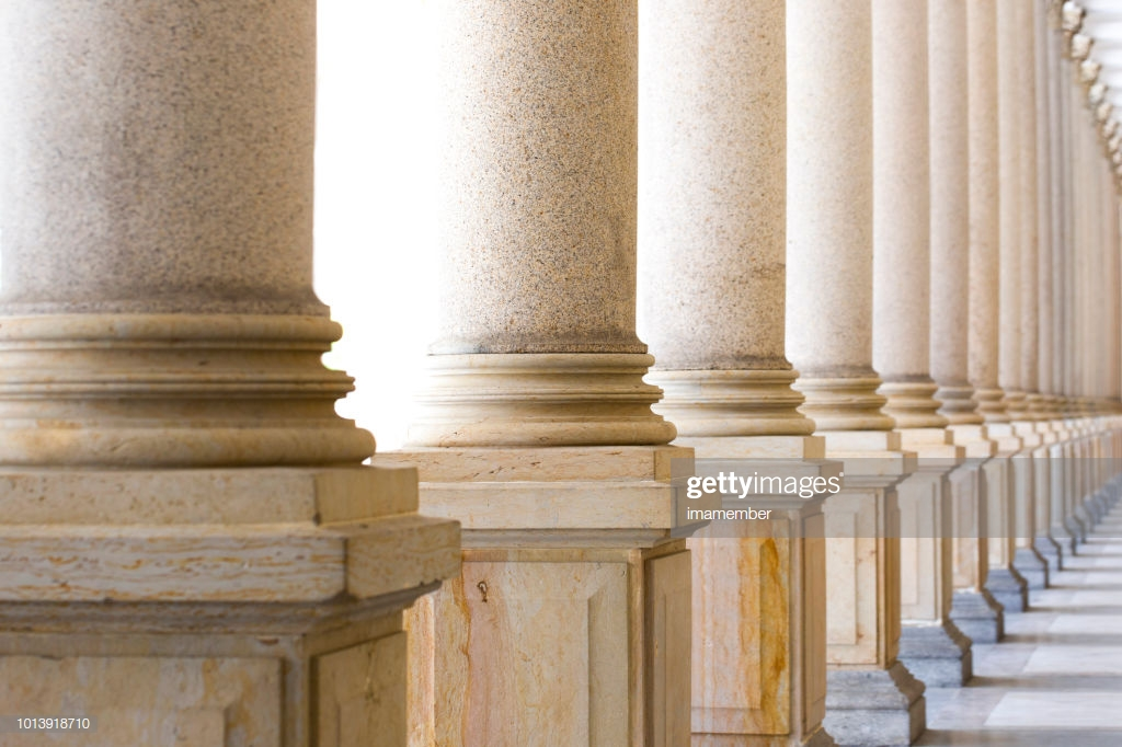 Colonnade Row Of Classical Stone Columns Background With Copy 1024x682