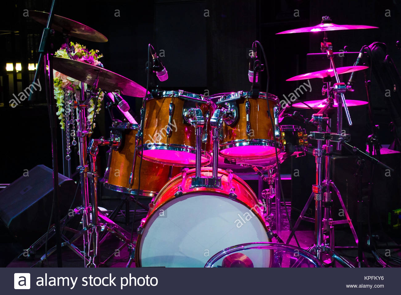 drum set on stage and magenta light background empty stage with 1300x956