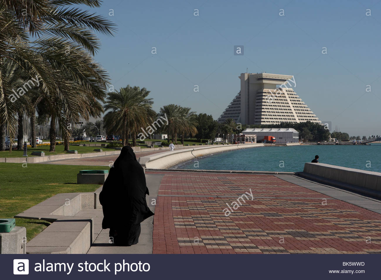 Arab woman walking along the Corniche with the Sheraton Hotel in 1300x956