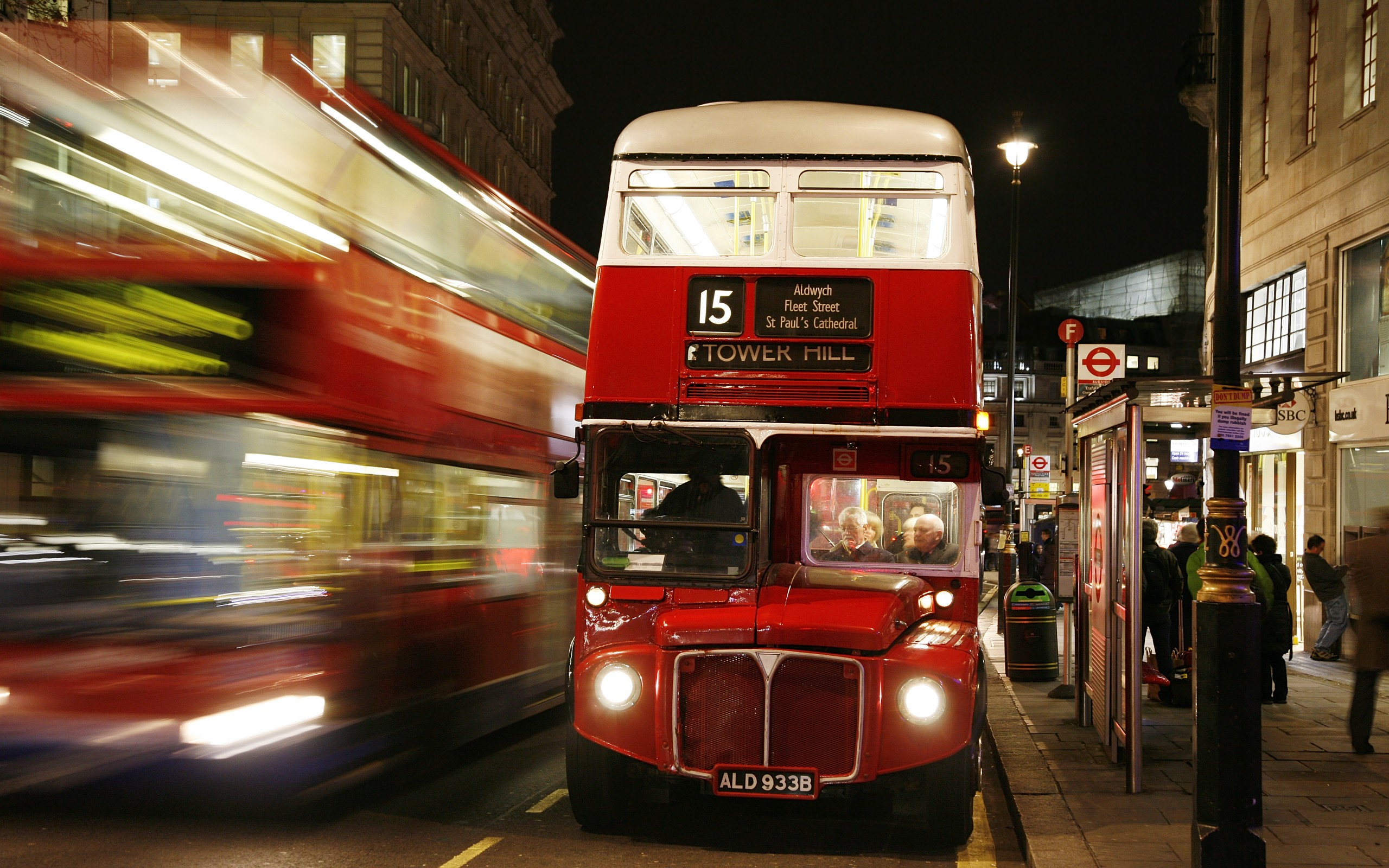 london england bus night lights people blur Passengers driver street 2560x1600