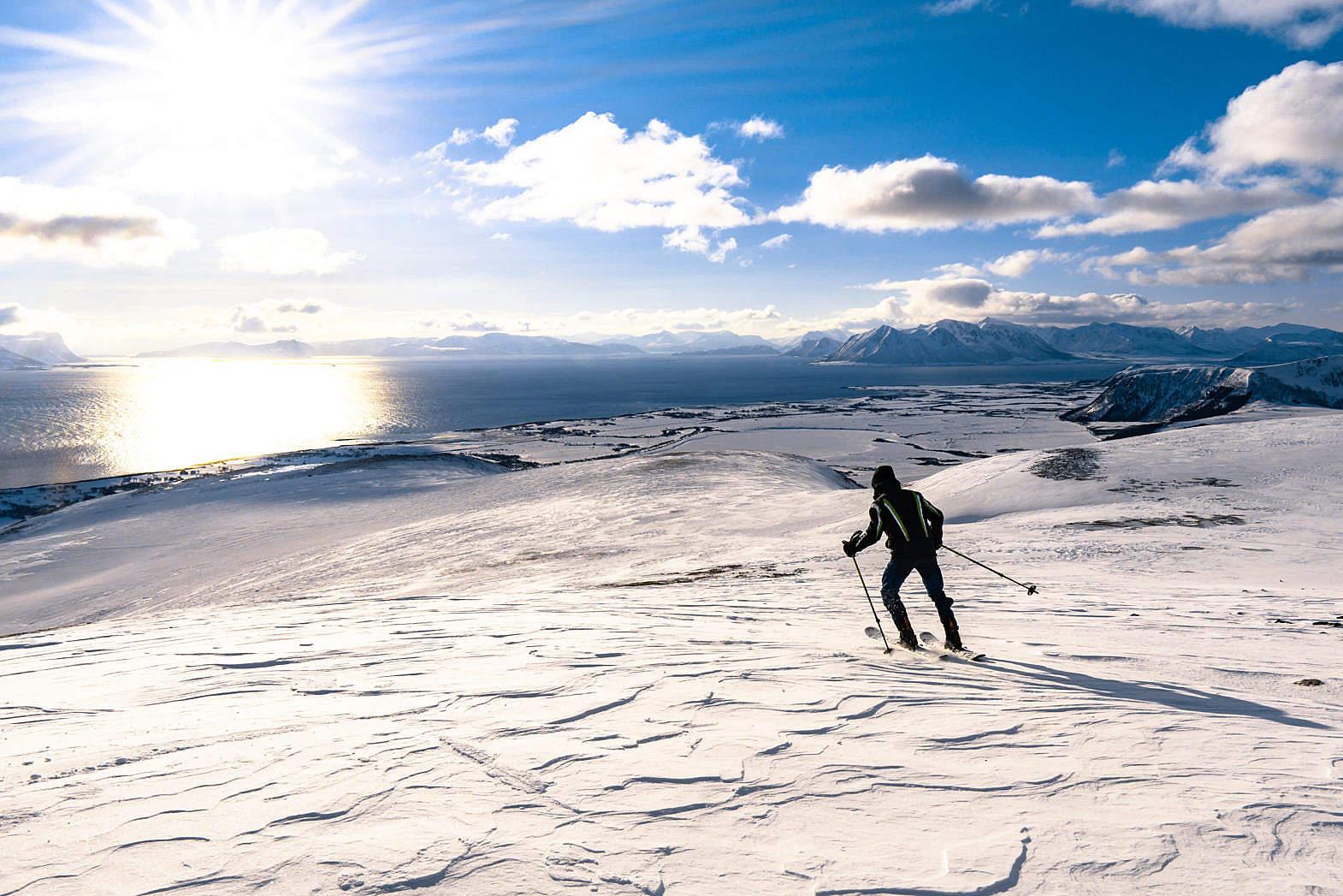 Man Skiing on Snowy Mountains of Norway Stock Photo picjumbo 1570x1047