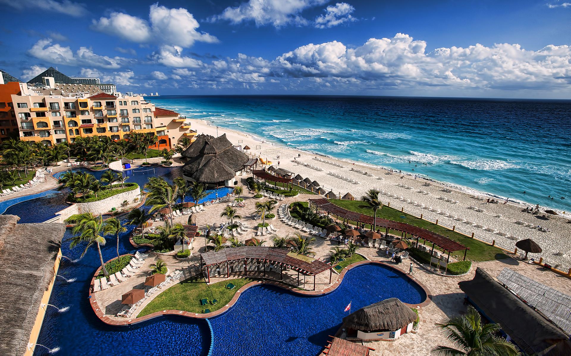 Tropical Beach Ocean Hotel ocean waves sky clouds wallpaper background 1920x1200