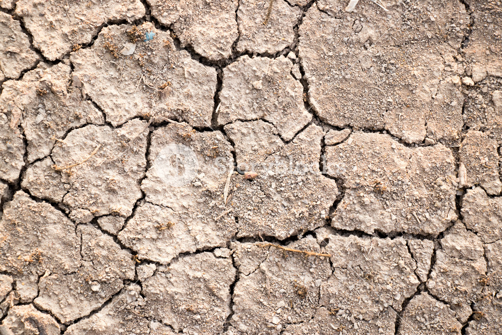 Cracked dry brown soil textured background global warming effect 1000x667
