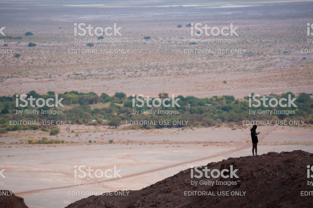 Single Person On Mountaintop Using Phone Moon Valley In Background 1024x683