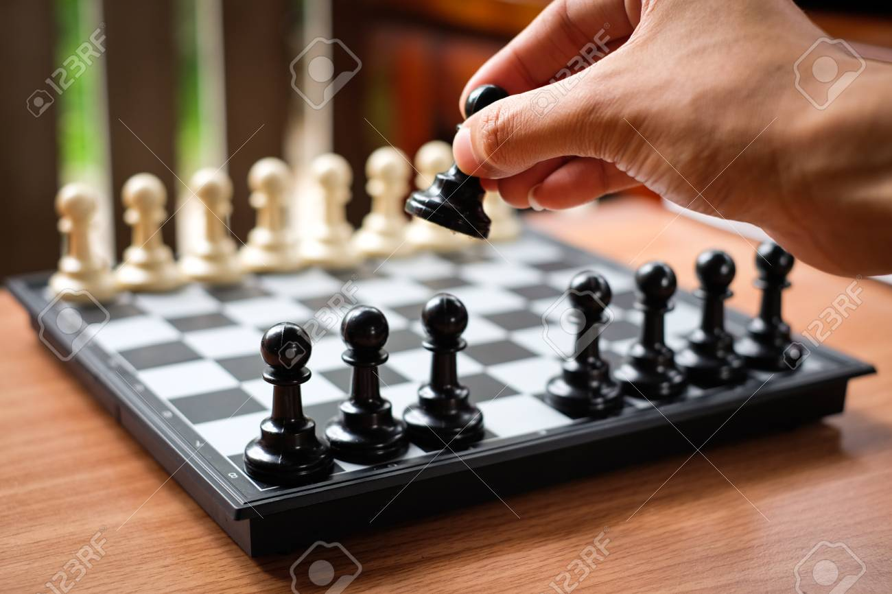 Hand Holding Chess Pawn For Leader Background Or Texture 1300x866