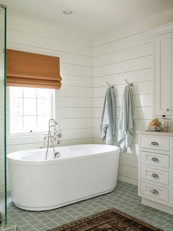 Serene bathroom with shiplap paneled walls framing sunny window with 555x740