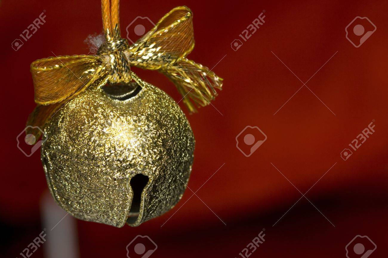 A Beautiful Background Of A Gold Jingle Bell On Red Background 1300x866