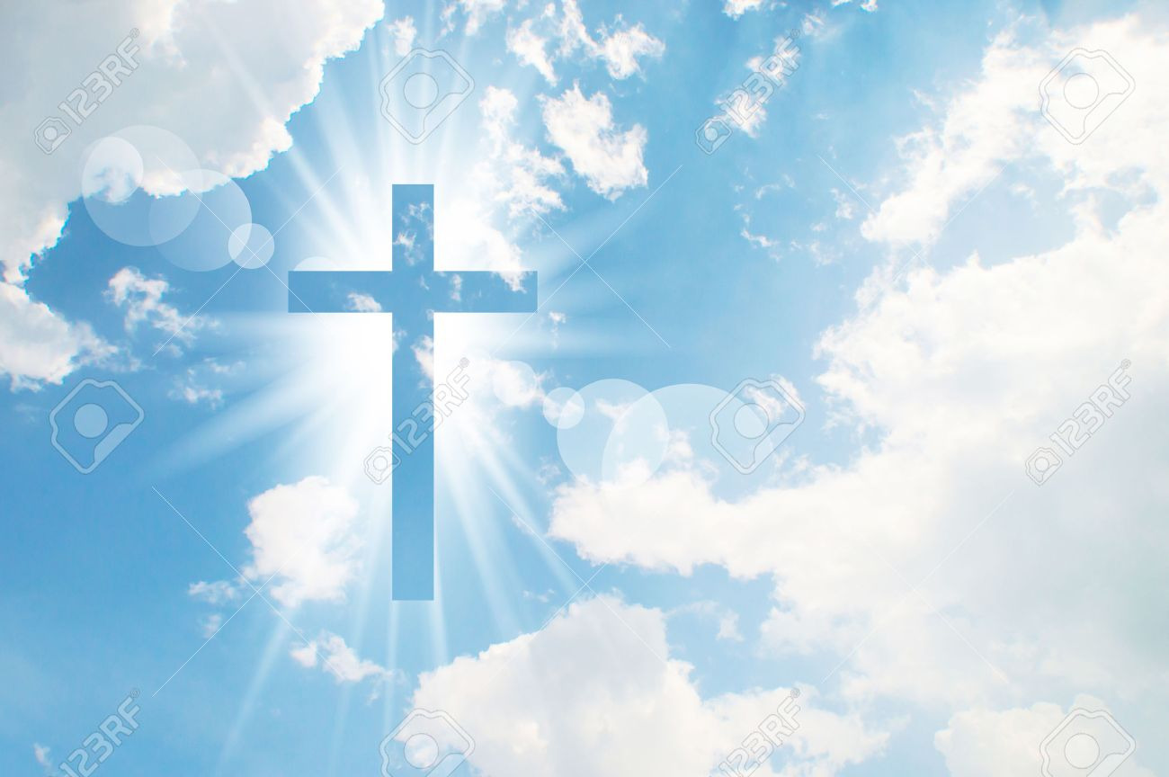 Christian Cross Appears Bright In The Sky Background Stock Photo 1300x864