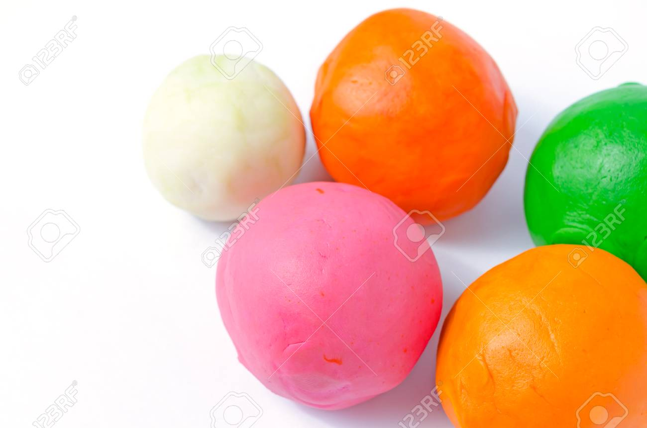 Colorful Playdough Balls On White Background Stock Photo Picture 1300x861