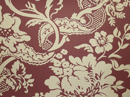 damask style wallpaper printed in beige on a burgundy background 534x401