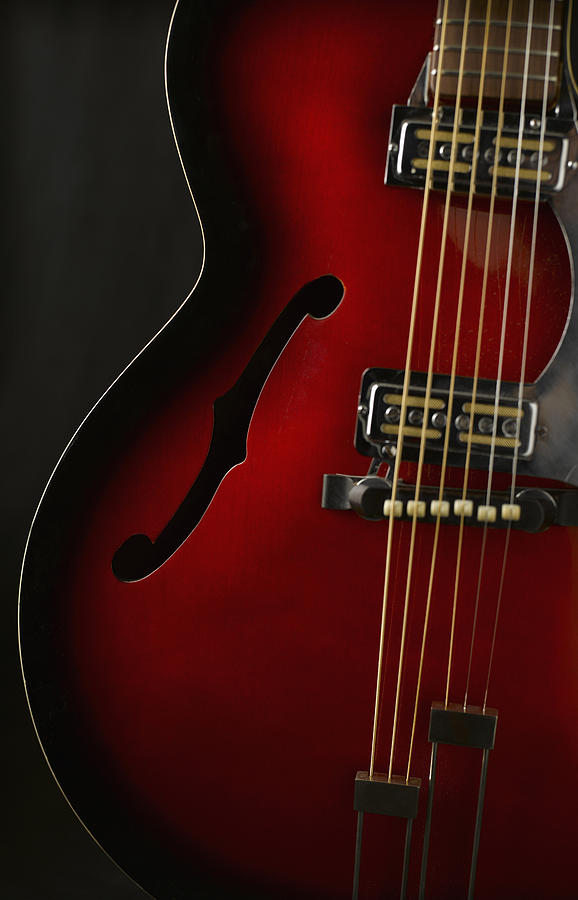 Guitar Against Black Background Close Up Photograph 578x900