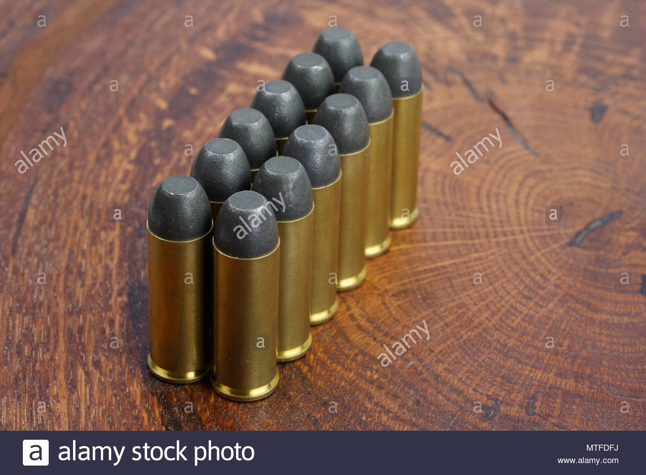 Revolver cartridges 45 Cal Wild West period on wooden background 1300x956