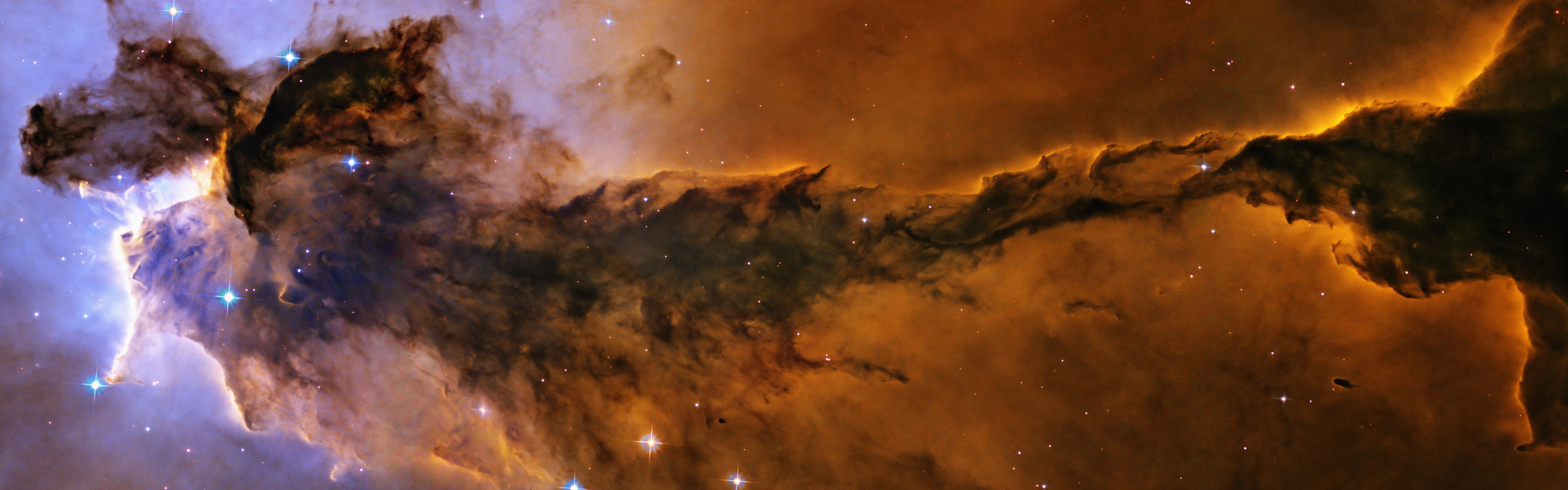 Billowing tower of cold gas and dust rising from the Eagle Nebula 3840x1200