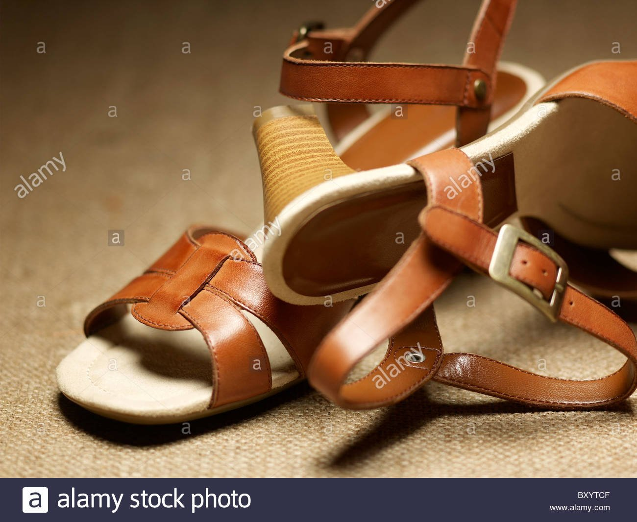 pair of womens shoessandals on a raffia background Stock Photo 1300x1066