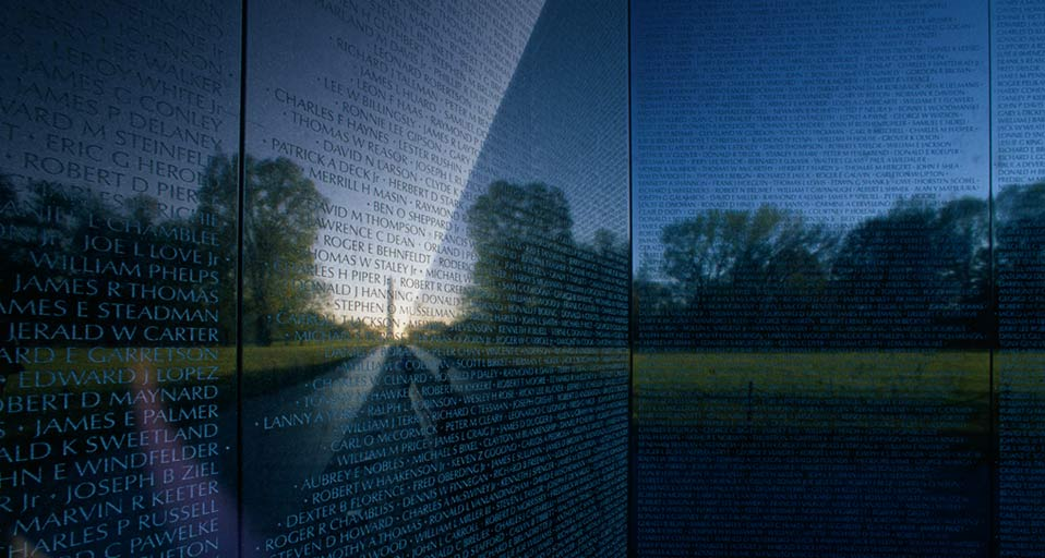 Washington Monument reflected in the Vietnam Veterans Memorial Wall 958x512