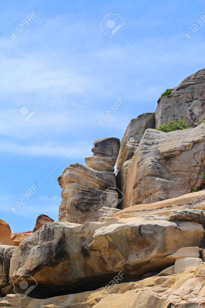 Top Of A Rocky Cliff With Blue Sky In The Background Stock Photo 866x1300