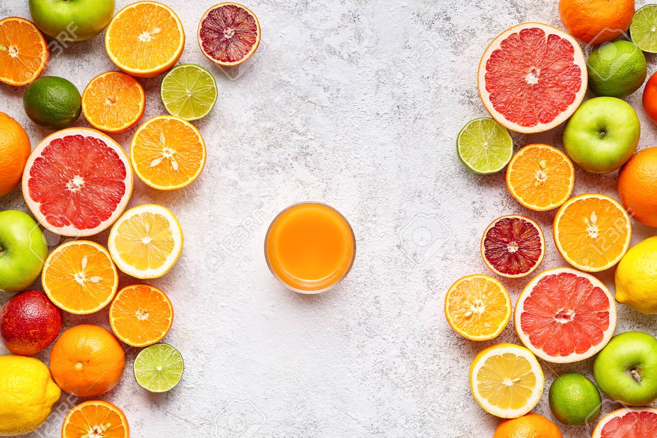 Smoothie Or Fresh Juice In Citrus Fruits Background Flat Lay 1300x866