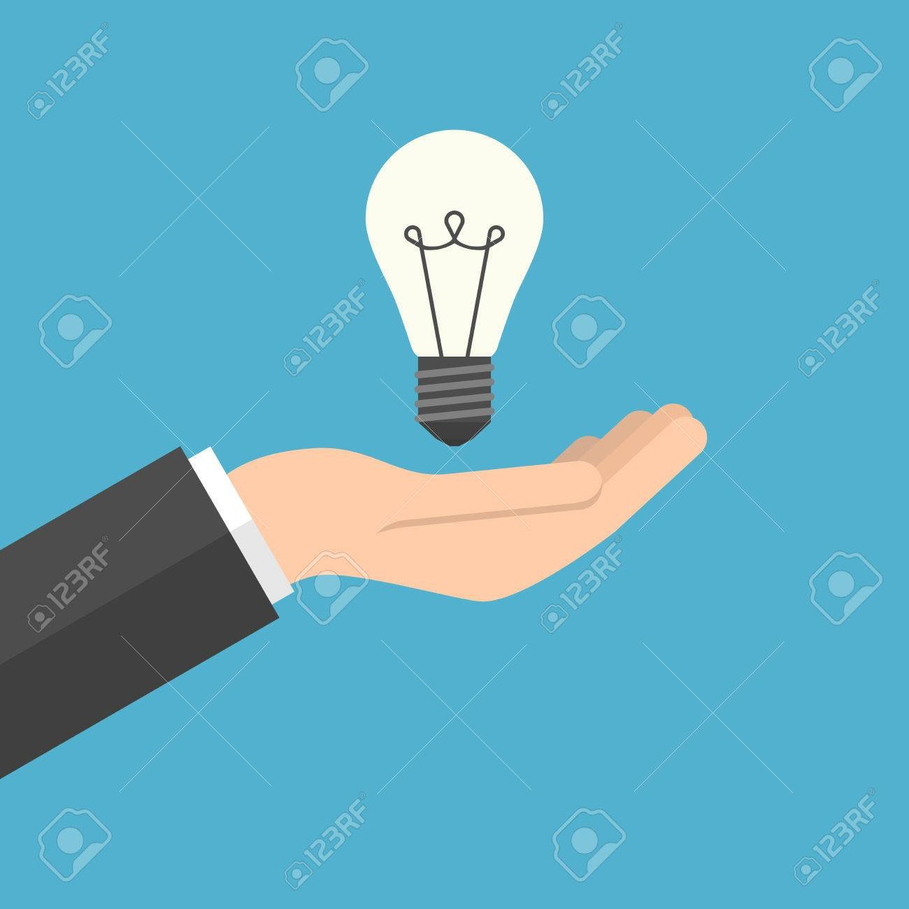 Lightbulb In Hand Businessman Isolated On Blue Background 1300x1300
