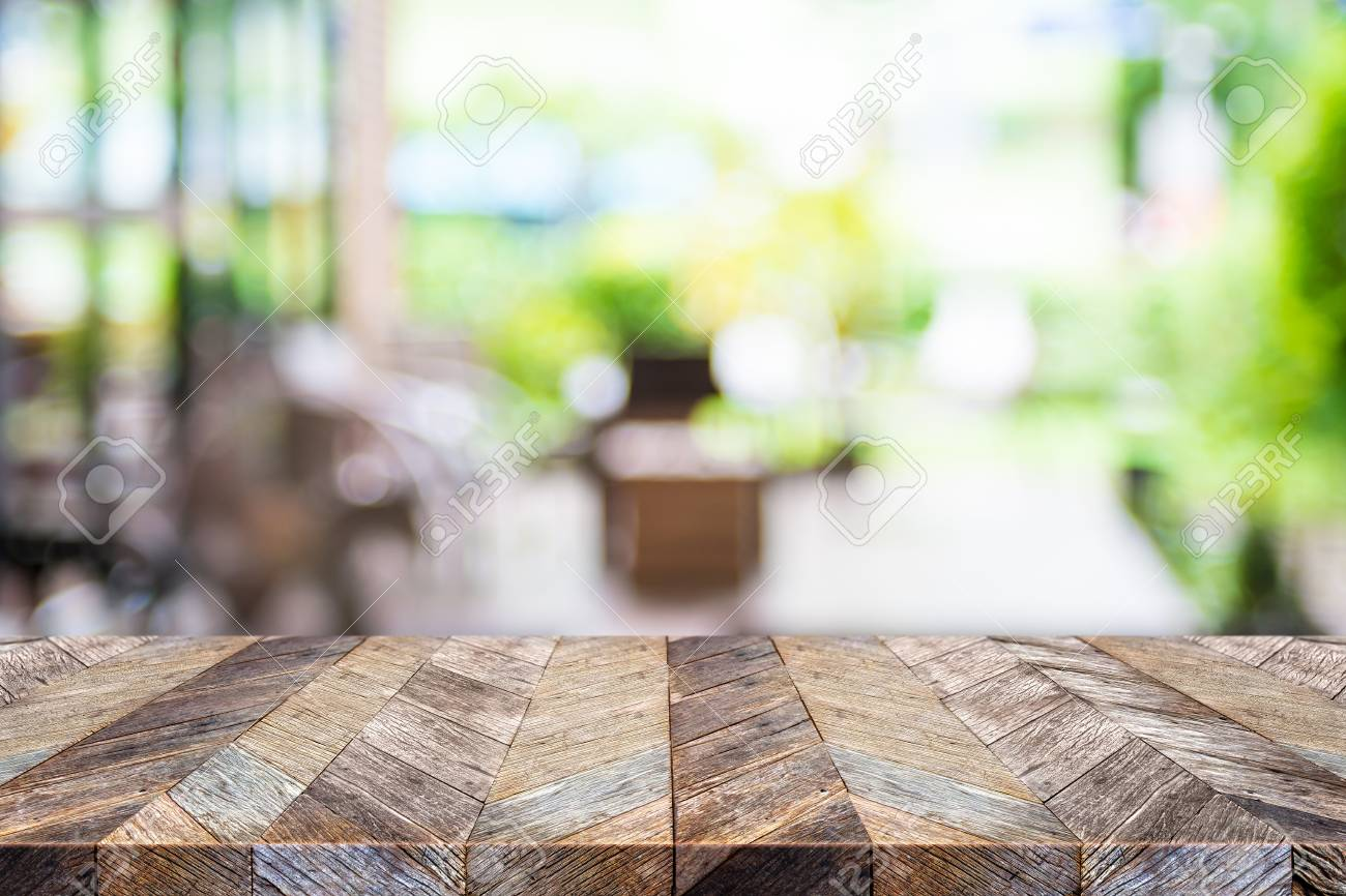 Empty Tropical Wood Table And Blurred Garden Cafe Light Background 1300x866