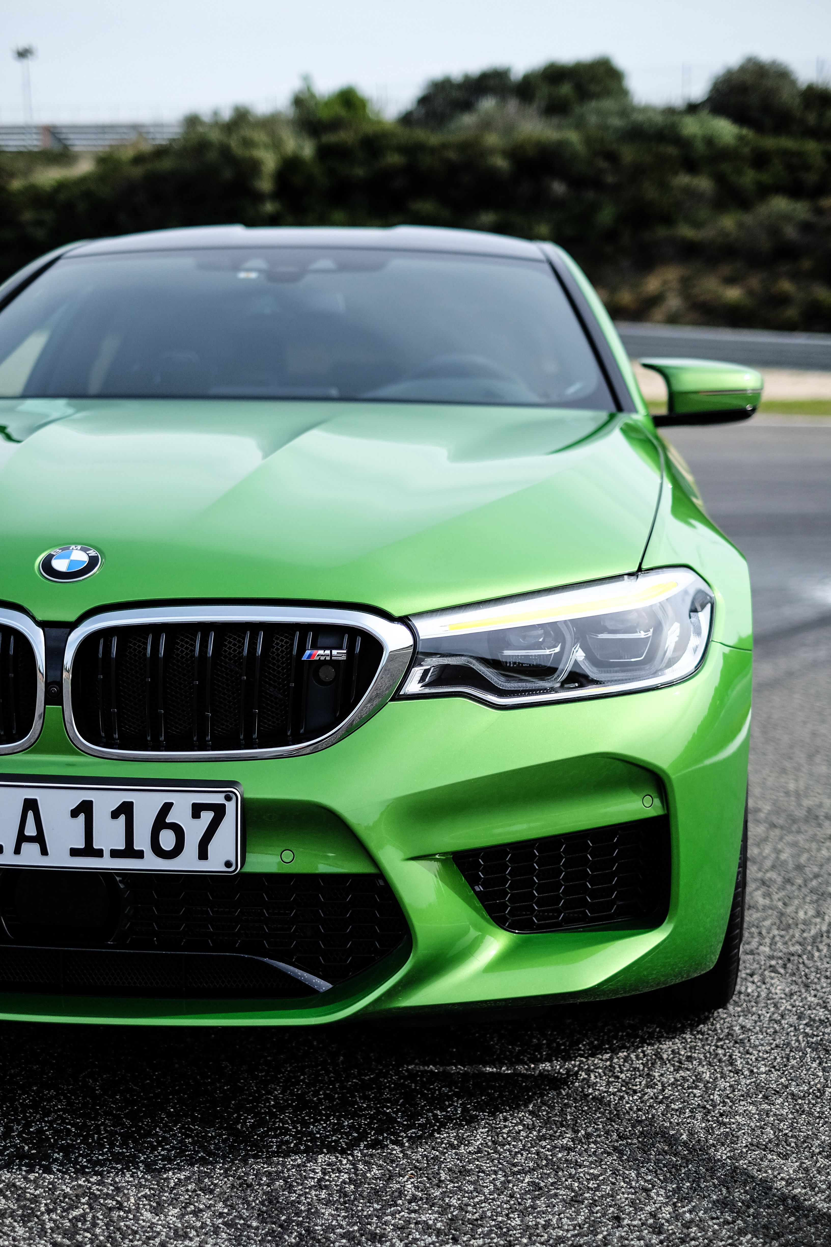 The all new BMW M5 in Java Green F90 Mobile Phone Screen Saver 3264x4896