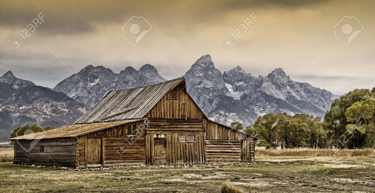 Old Barn With The Grand Tetons In The Background Stock Photo 1300x670