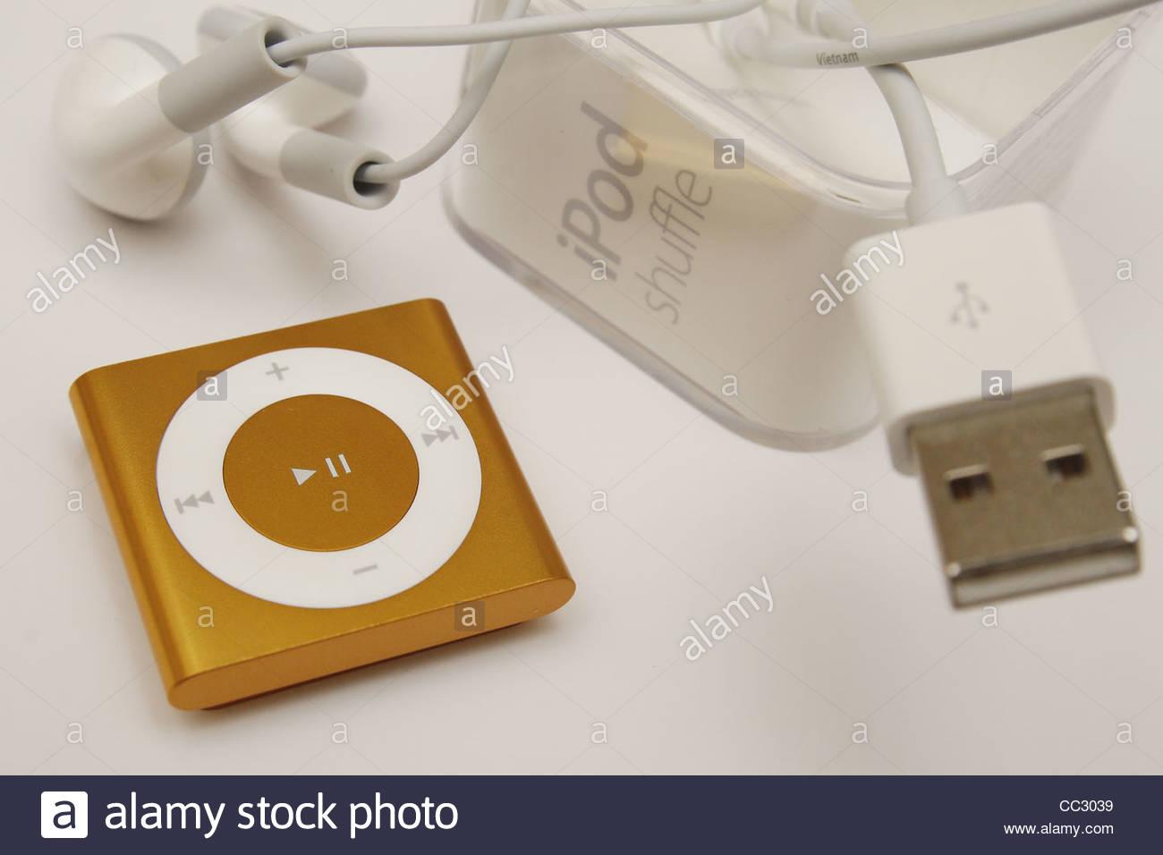 image of ipod shuffle against plain background Stock Photo 1300x956