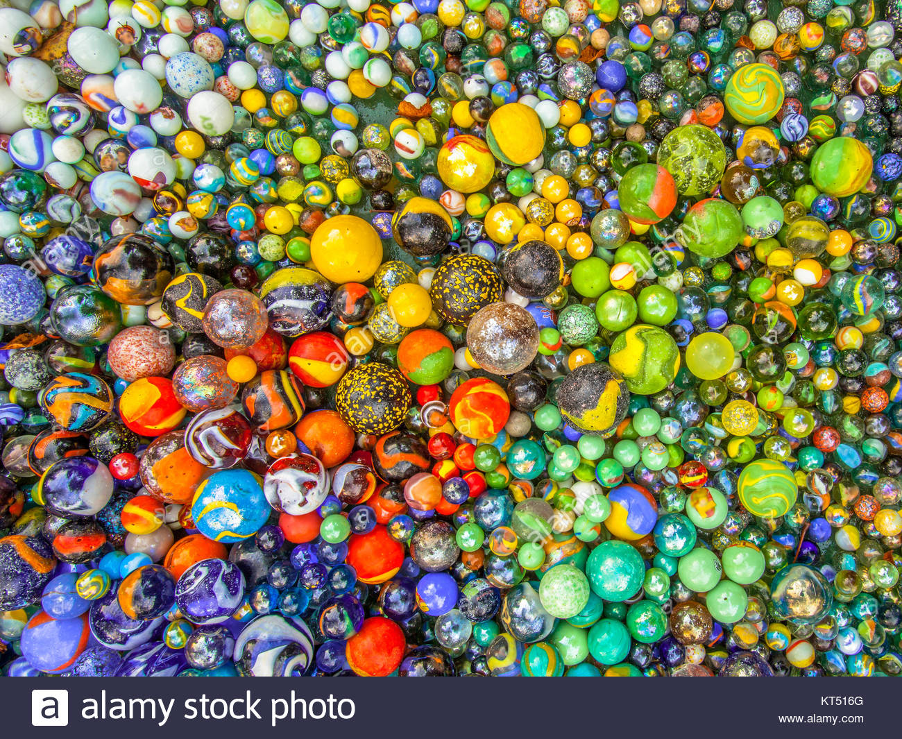 background of colorful Glass marbles of different sizes in a color 1300x1065