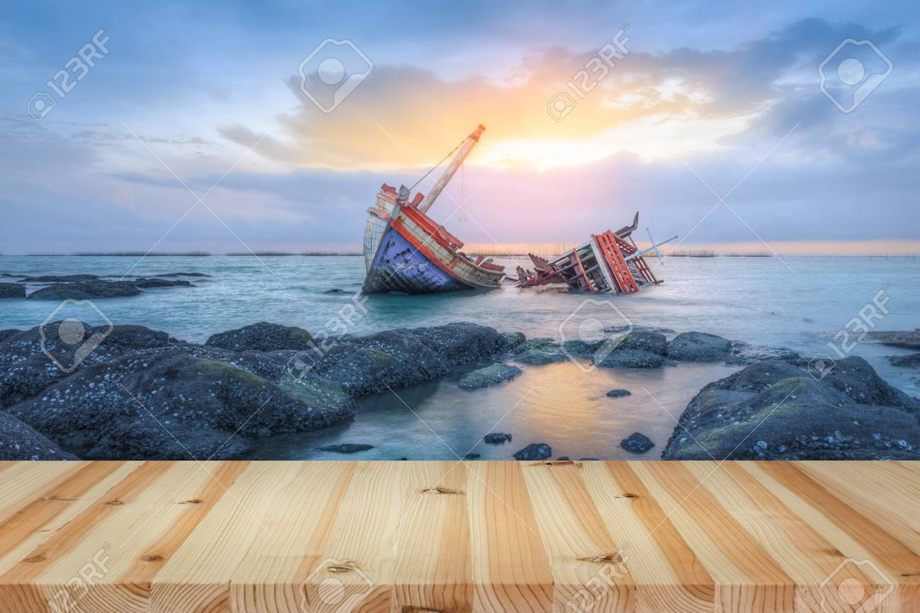Ancient Shipwrecks In The Sea With Sunset Background Stock Photo 1300x866