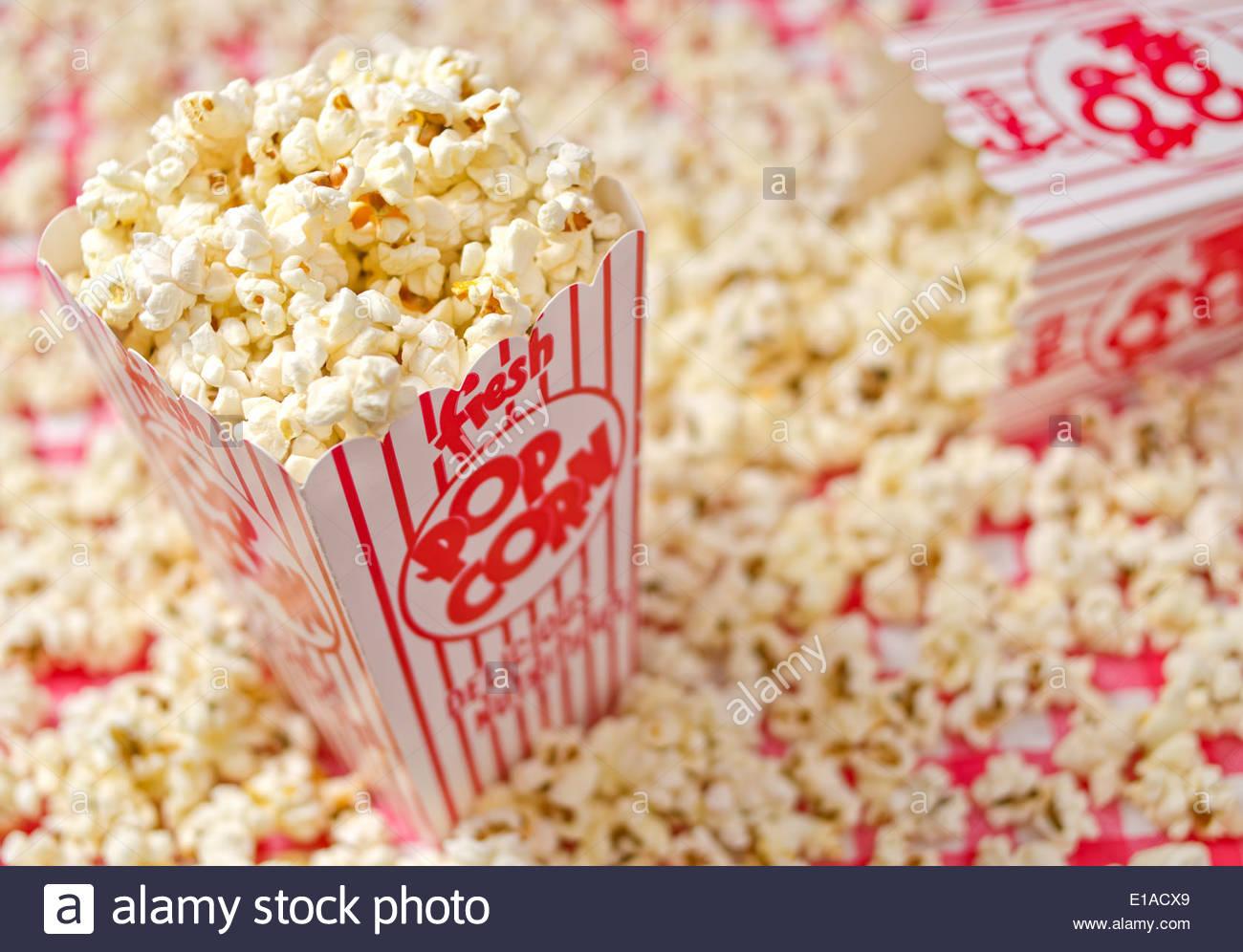 Freshly popped popcorn against a popcorn background Stock Photo 1300x996