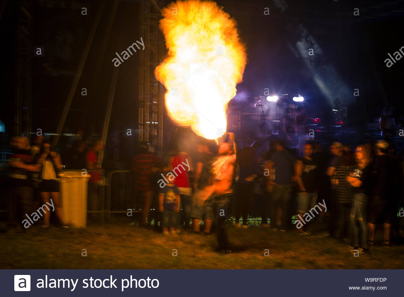 Motion blurred night shot showing a fire eater jugglers torches 1300x956