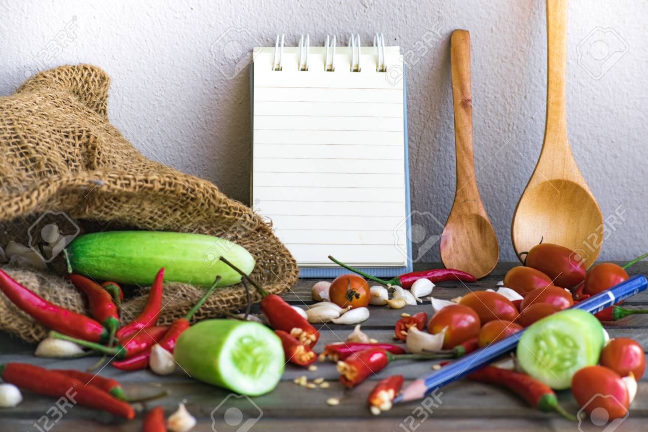 Notepad With Spoons And Vegetable On Wood Wood BackgroundUsing 1300x866
