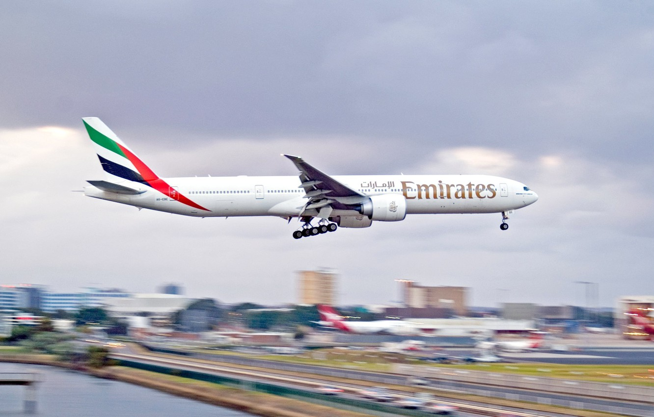 Wallpaper the city airport Boeing the plane 300 777 Landing 1332x850