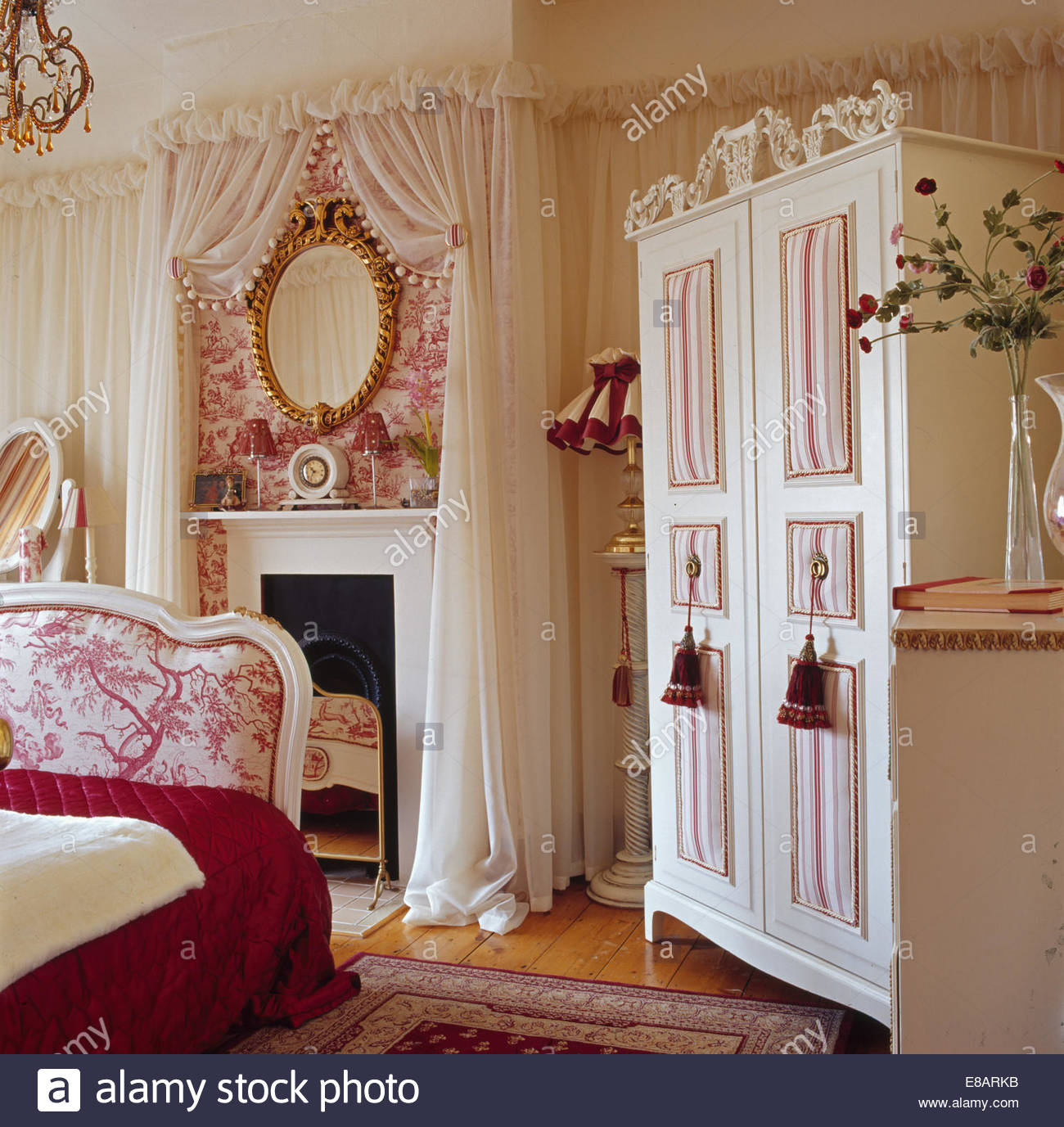 Cream wardrobe in bedroom with cream voile drapes on walls and 1300x1377