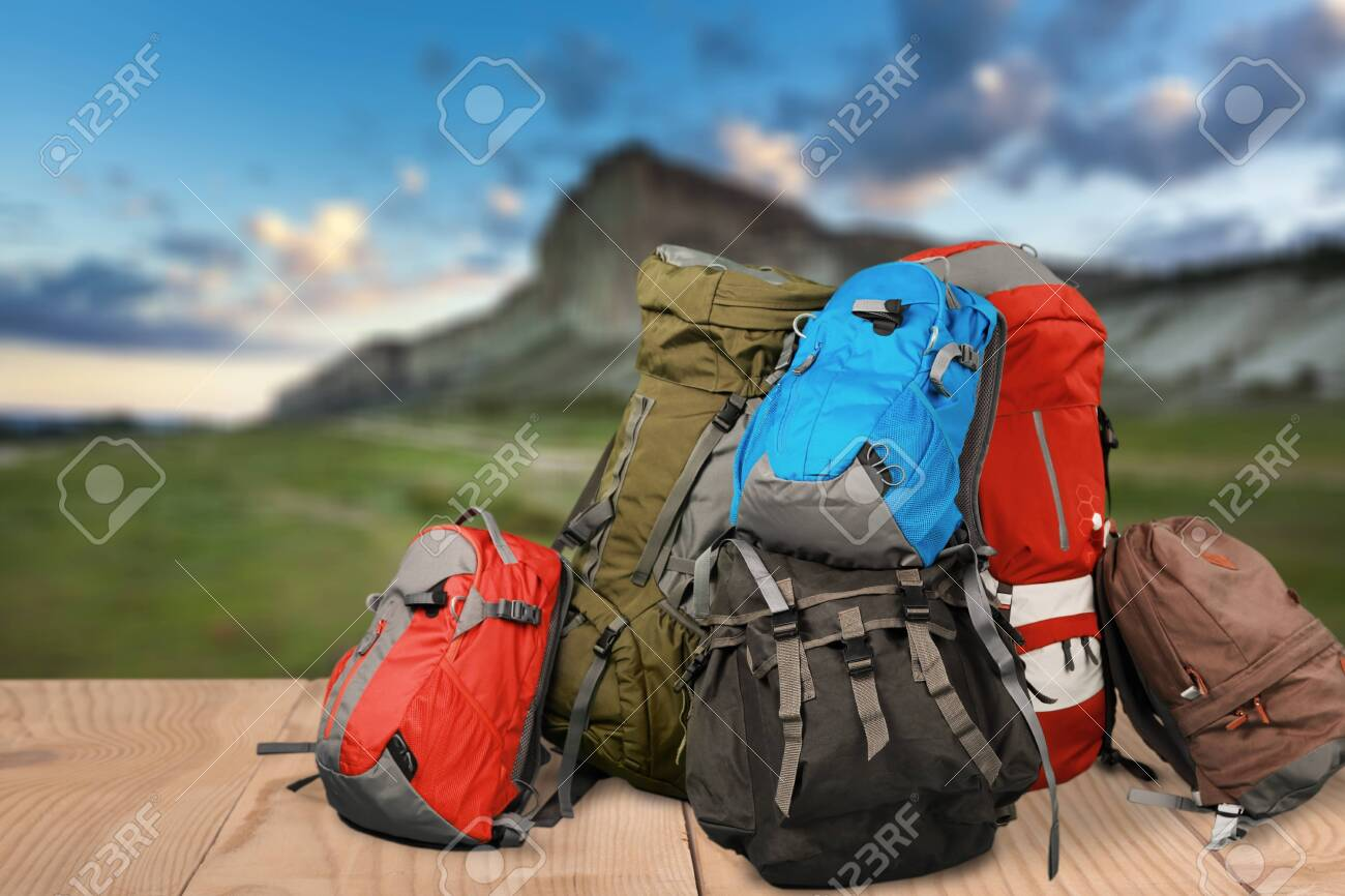 Tourists Backpacks For Leisure Activities On Background Stock 1300x866