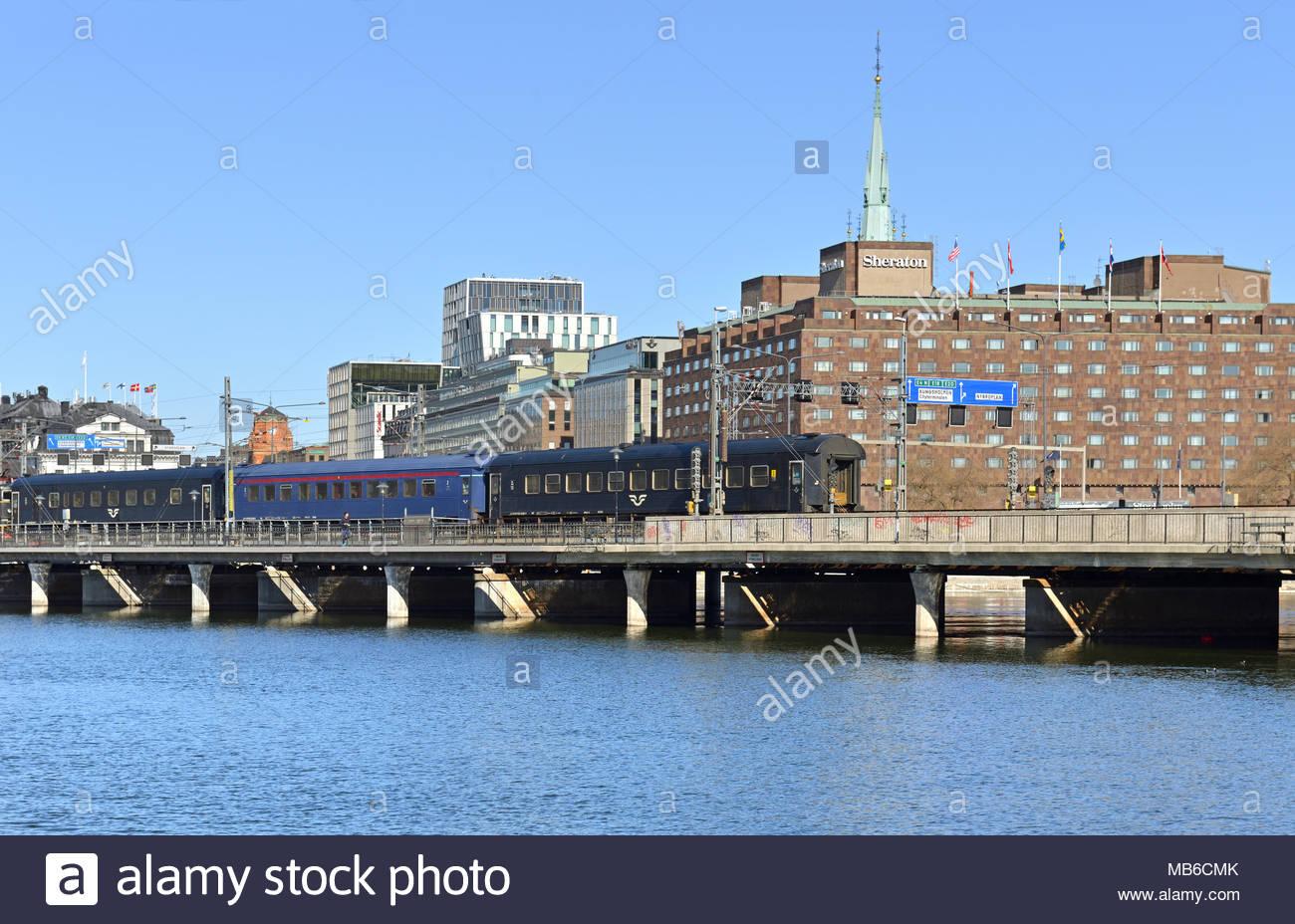Train on Central Bridge Centralbron on background of Sheraton 1300x928