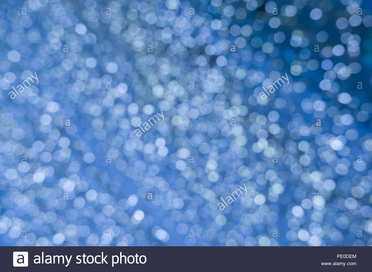 Abstract blue bokeh circles for Christmas background Royalty high 1300x951