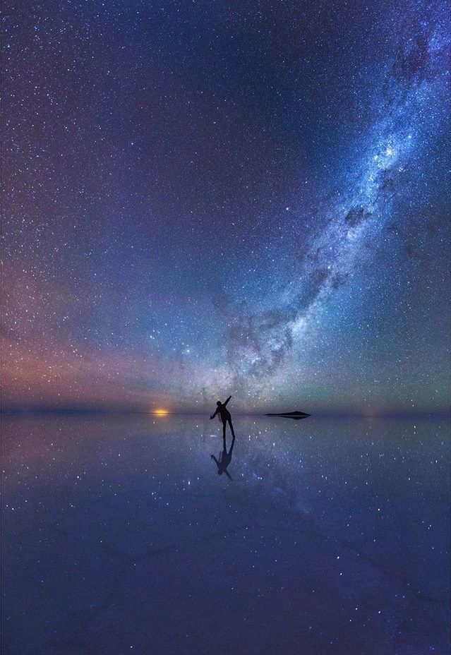 Dancing among the stars Salar de Uyuni Bolivia travel Night 639x928